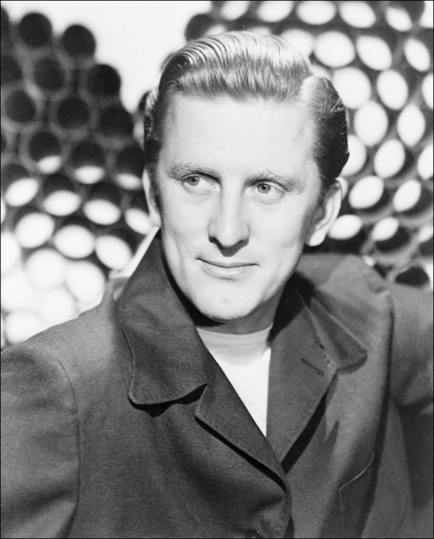 Kirk Douglas Actor Spartacus Cleftchinned steelyeyed and virile star of international cinema who rose from being the ragmans son the name of his best